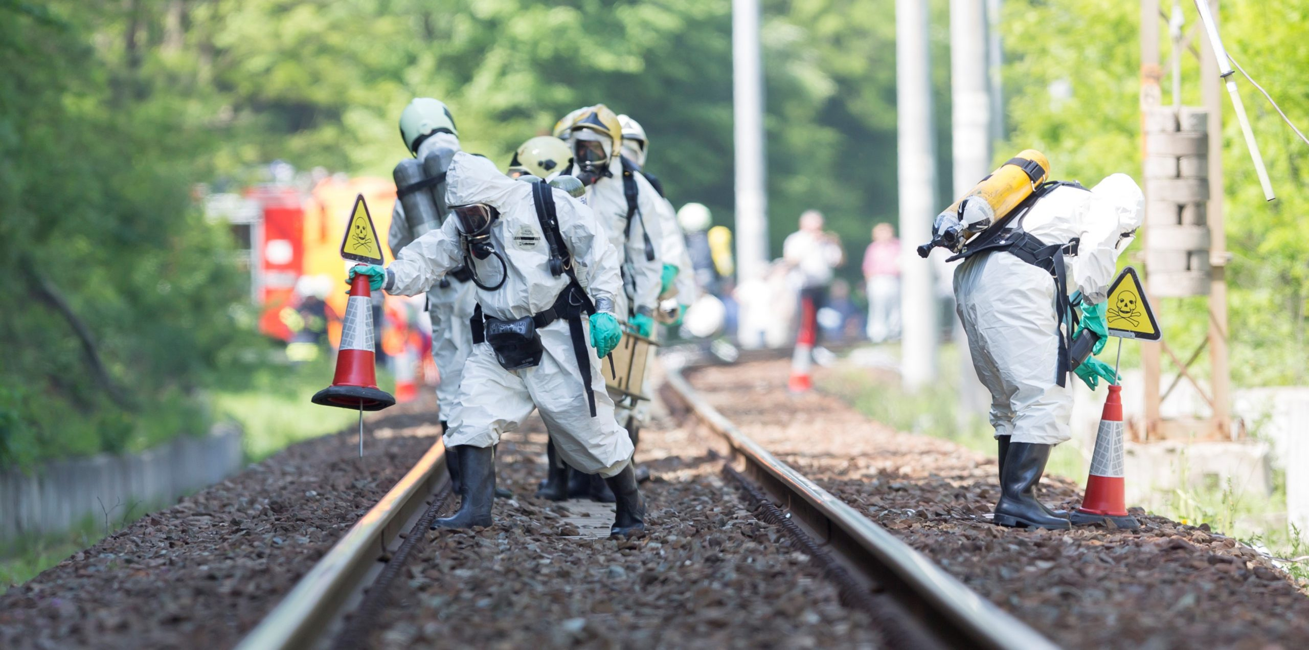 Sofia, Bulgaria - May 19, 2015: A team working with toxic acids and chemicals is approaching a chemical cargo train crash near Sofia. Teams from Fire department are participating in an emergency training with spilled toxic and flammable materials.
